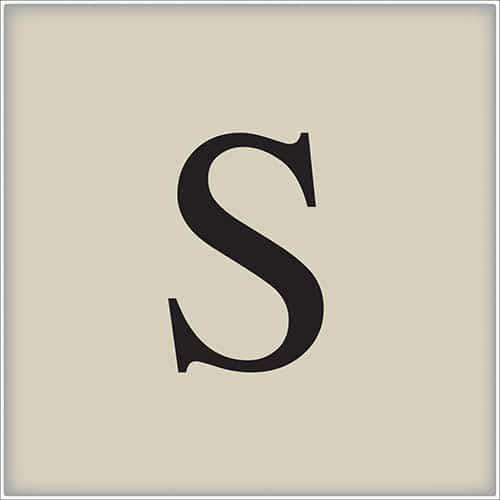 Sticker adhésif beige et noir lettre