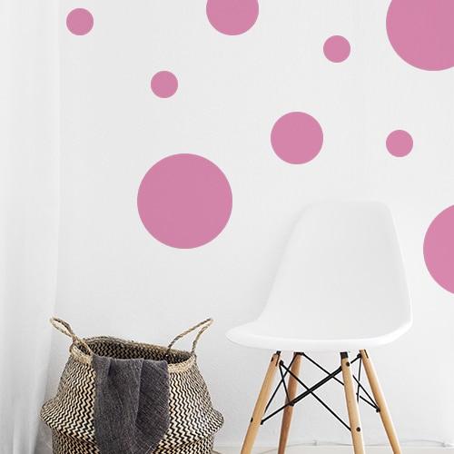 Sticker autocollant rond rose pour décoration de mur blanc de salon