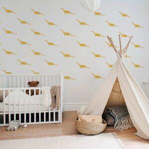 Frise de stickers décoratifs dinosaure jaune dans une pièce à jouer pour enfants