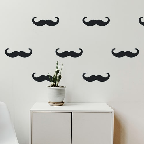Frise murale noire composée de moustache en croc