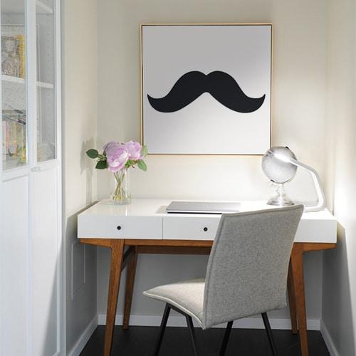 tableau mural orné d'un sticker moustache épaisse noire