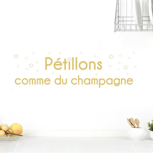 Adhésif citation champagne sur mur blanc