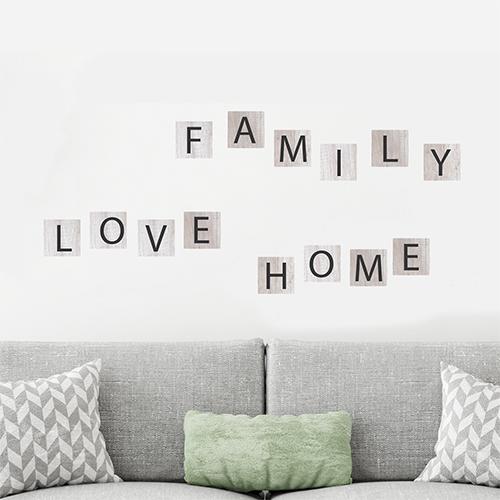 Adhésif citation family love home pour décoration mur blanc de salon