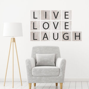 Sticker mural Live Love Laugh Noir sur fond gris dans un salon
