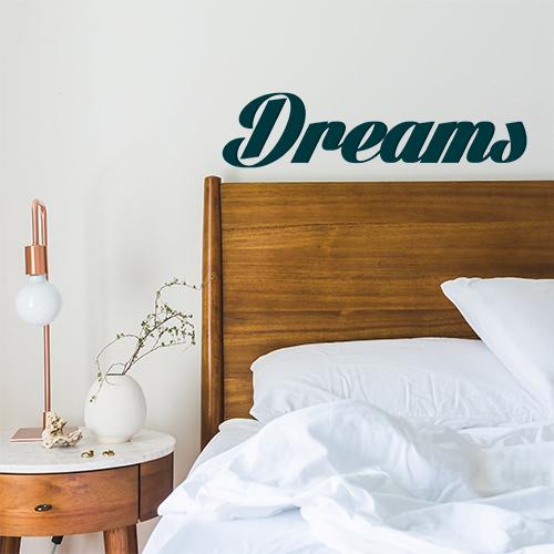 Sticker autocollant citation Dreams au dessus d'une tête de lit