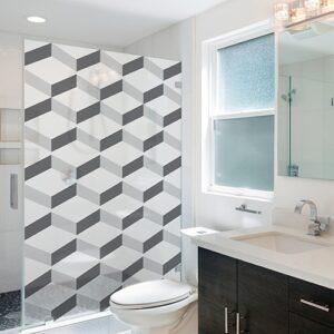 Sticker décoratif autocollant Chevrons 3D blanc collé sur la douche d'une petite salle de bain avec WC