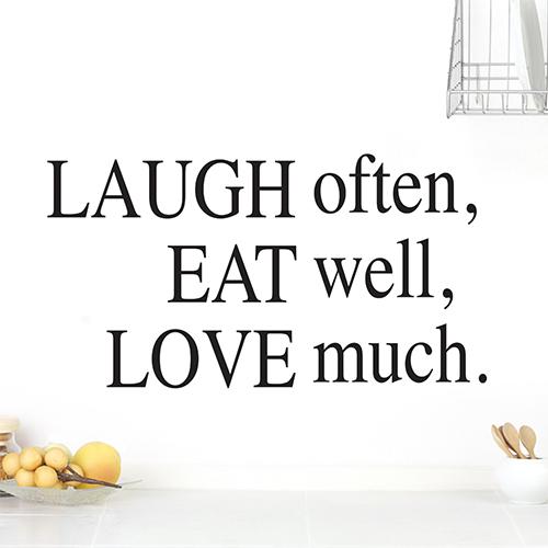 Sticker autocollant Laugh Often citation sur un mur blanc