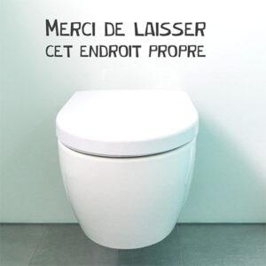 WC classique blanc avec un sticker décoratif Merci de laisser propre