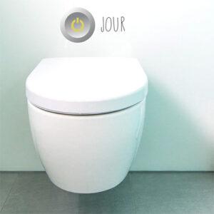 Sticker autocollant interrupteur jour collé sur un WC blanc
