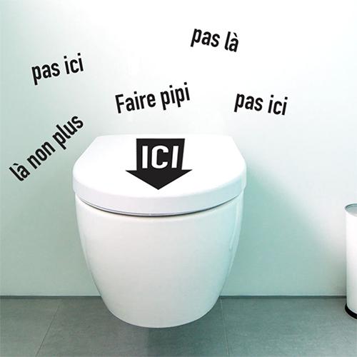 Sticker rigolo Faire pipi ici collé sur des toilettes modernes