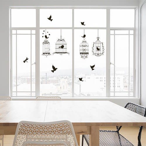 Grande baie vitrée personnalisée avec un ensemble de cage à oiseaux et silhouettes d'oiseaux poétiques qui sont des stickers électrostatiques pour vitres.