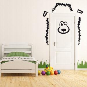 """Autocollants """"dessus de porte mouton"""" disposés autour de la porte d'une chambre d'enfants"""