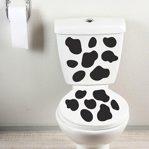 Décoration pour WC motif Vache collée à des WC