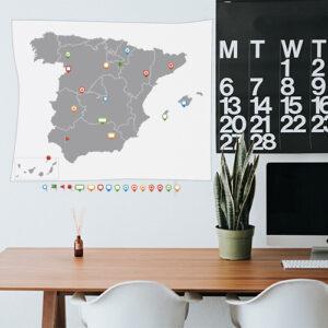 "Autocollants ""carte d'Espagne"" disposés sur mur de bureau"