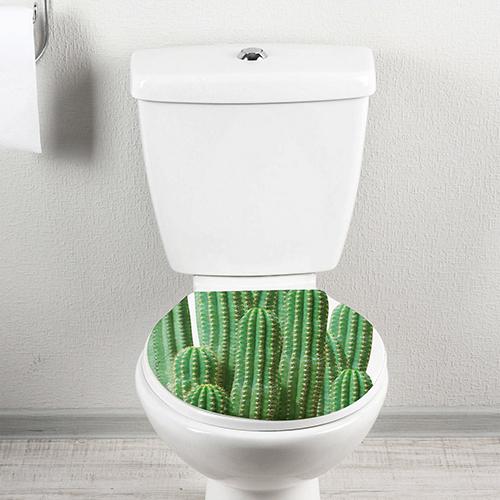Sticker original cactus collé sur des wc