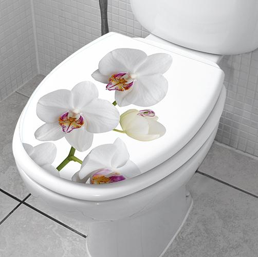Sticker autocollant décoratif collé sur le siège des toilettes