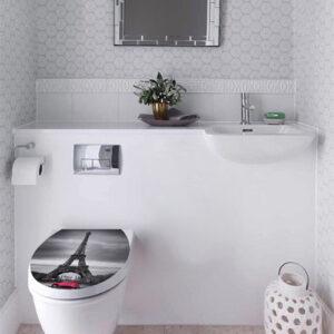 Tour eiffel noire et blanche collée sur l'abattant des wc