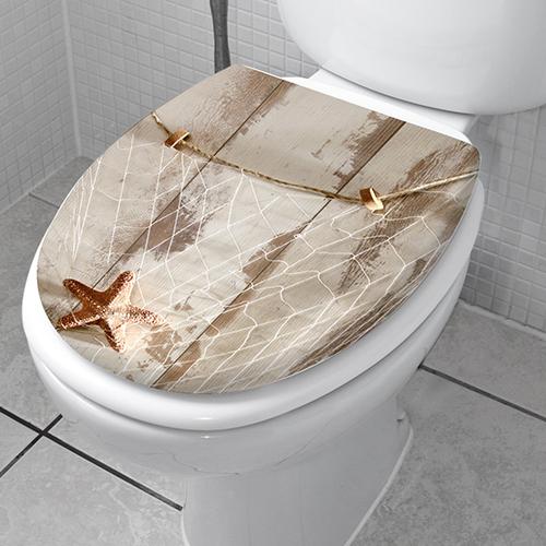 Sticker décoratif original modèle filet de peche collé sur des wc