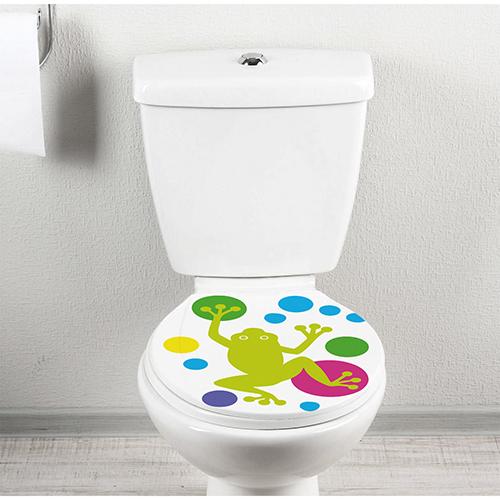 Abattant de toilette orné d'un sticker grenouilles