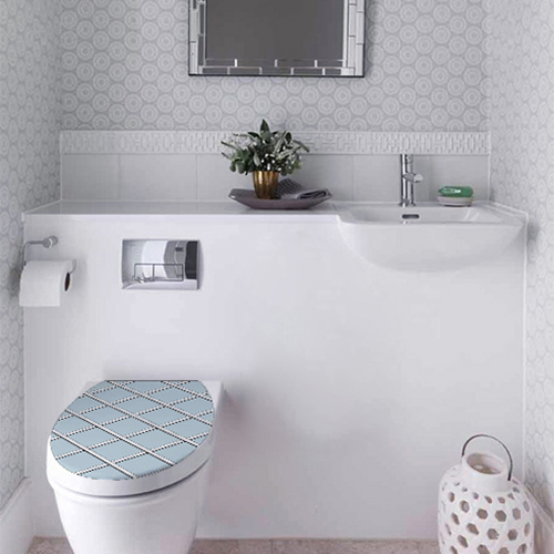 Sticker autocollant pour WC motif géométrique bicolore collé sur un WC classique