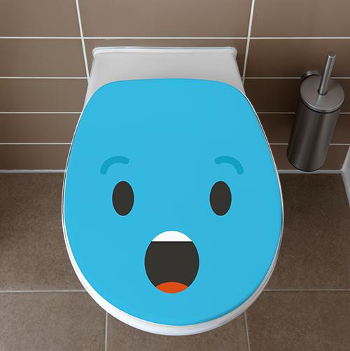 Sticker pour WC de la gamme Smiley : Smiley étonné bleu collé sur des toilettes