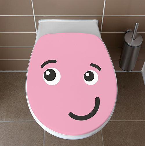 Smiley Rose Taquin collé sur un WC