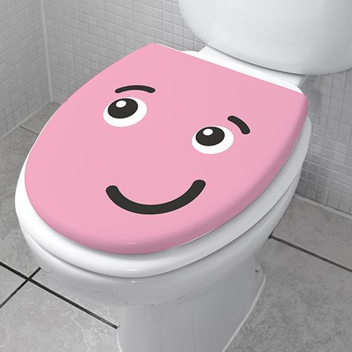 Abattant de toilette décoré avec un Smiley Taquin Rose de la gamme Smiley
