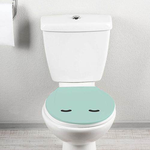 Smiley Endormi Turquoise collé sur un toilette blanc