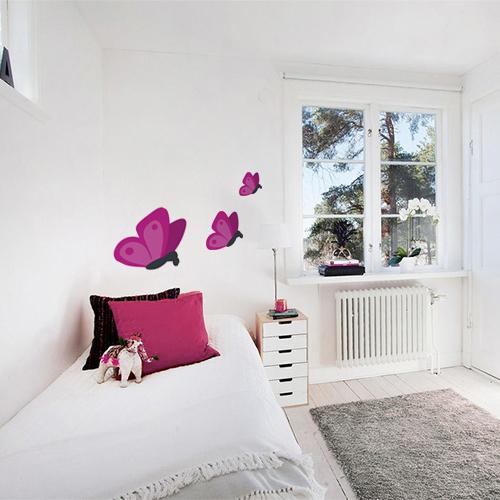 Adhésif pour chambre d'enfant mur blanc déco papillon rose