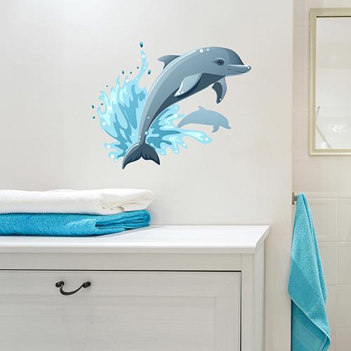 sticker dauphin qui saute déco murale au dessus d'un meuble de salle de bain