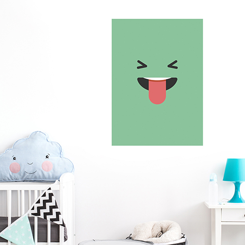 sticker smiley tire la langue vert au mur d'un coin pour enfants