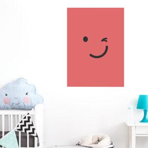 sticker smiley clin d'oeil rouge au mur d'une chambre d'enfant