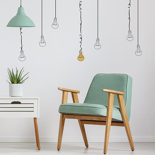 """Autocollants """"ampoules fil"""" sur mur de séjour comme des appliques fil ampule qui sont des lampes suspendues."""