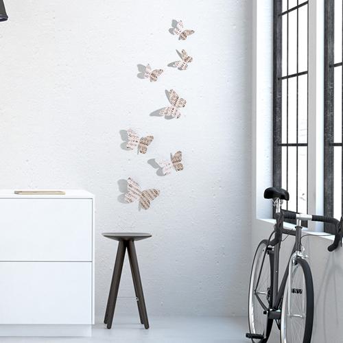 Sticker mural Papillons musique concerto dans un salon avec un vélo et une table basse