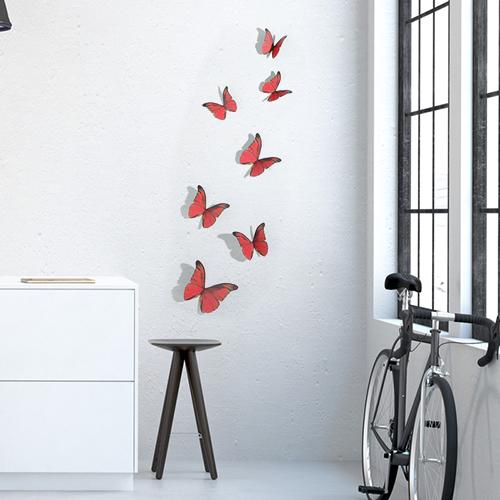 Sticker mural Papillons rouges sur un mur blanc avec un vélo