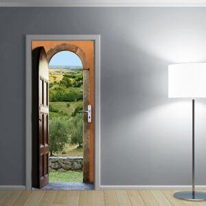 sticker porte Panorama de Provence avec une lampe sur mur gris pour voyager visuellement dans la nature provençale, ses oliviers et ses murs de pierre sèches