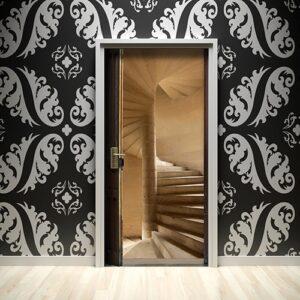 Notre sticker Escalier à vis pour porte sur mur design
