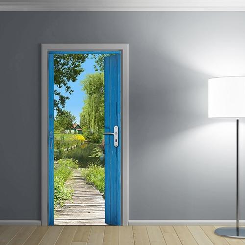Sticker de porte d'une Cabane des Marais avec lampe design blanche sur mur gris