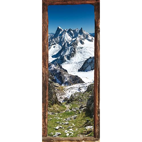 Adhésif collable pour porte avec vue sur la montagne dans les Alpes au milieu des la neige et de l'herbe fraîche du printemps pâturage haute montagne