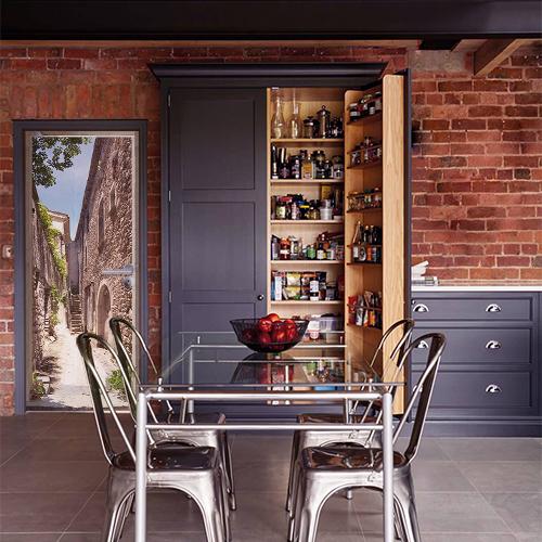 Dans une ambiance ancienne usine gris métal orange brique et bois, sticker porte provence ou sud de la France rue d'un village avec maison en vielles pierres sèchent