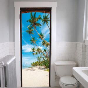 Dans votre salle de bain, installez le sticker adhésif en trompe l'oeil montrant une plage paradisiaque en sable blanc avec une mer bleue turquoise et des palmiers magnifiques