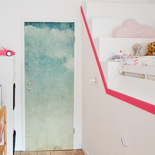 Sticker adhésif décoratif collé sur la porte d'une chambre pour enfant modèle mer turquoise