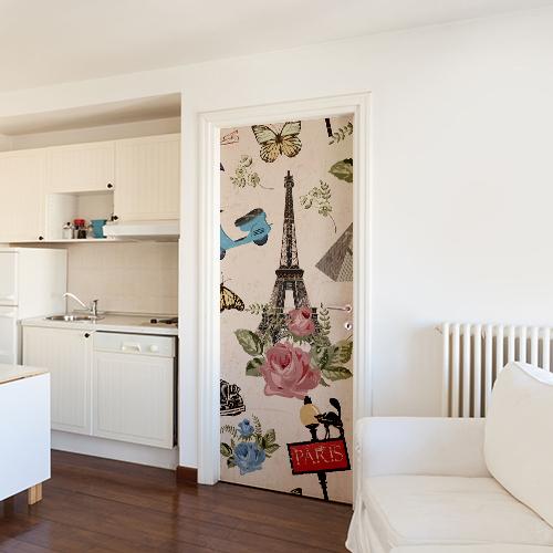 Sticker adhésif déco modèle Paris Tour Eiffel mettant en valeur la porte sur un mur blanc
