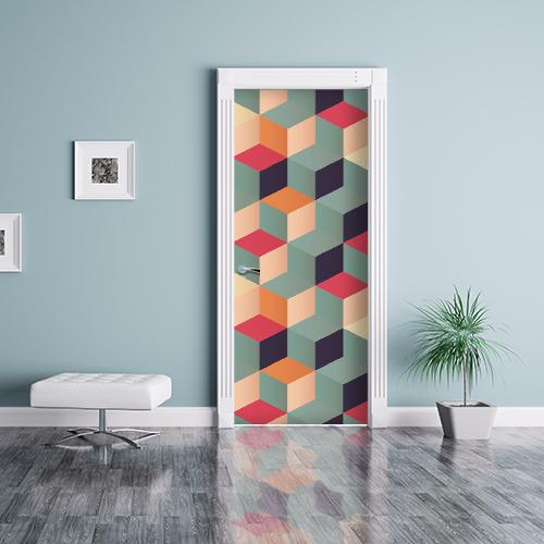 Appartement blanc dont la porte est ornée d'un sticker en 3D représentant des cubes de toutes les couleurs
