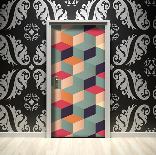 Sticker adhésif cubes en 3D de toutes les couleurs collé sur une porte dans une maison dont le mur est noir