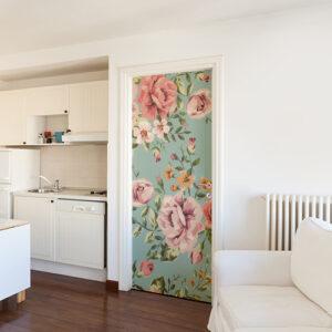 Salon tout blanc avec un sticker adhésif autocollant modèle fleurs roses collé sur la porte