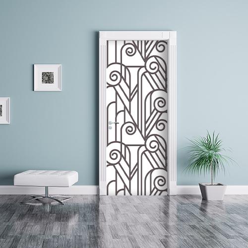 Sticker adhésif blanc et noir imitation vitraux créant le contraste avec le mur bleu