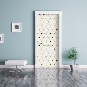 Pièce à vivre bleue dont la porte est ornée d'un sticker autocollant motif géométrique blanche et noire