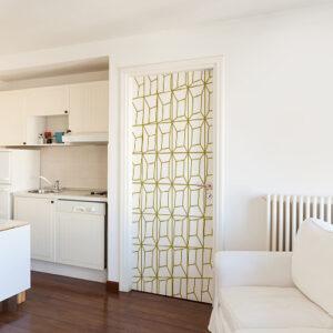 Porte de studio blanc avec un sticker autocollant lingots blancs et or collé dessus
