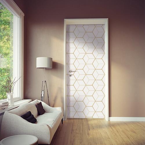 Studio spacieux blanc avec un sticker adhésif WSH modèle cubes en 3D blanc et or collé sur la porte